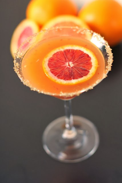 The Spicy Citrus Cocktail | Fake Food Free | A spicy rum cocktail made with orange and tangerine juices and a splash of sriracha!