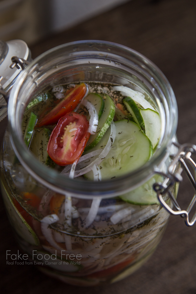 Quick Pickled Salad Recipe with tomatoes, cucumbers, and onions