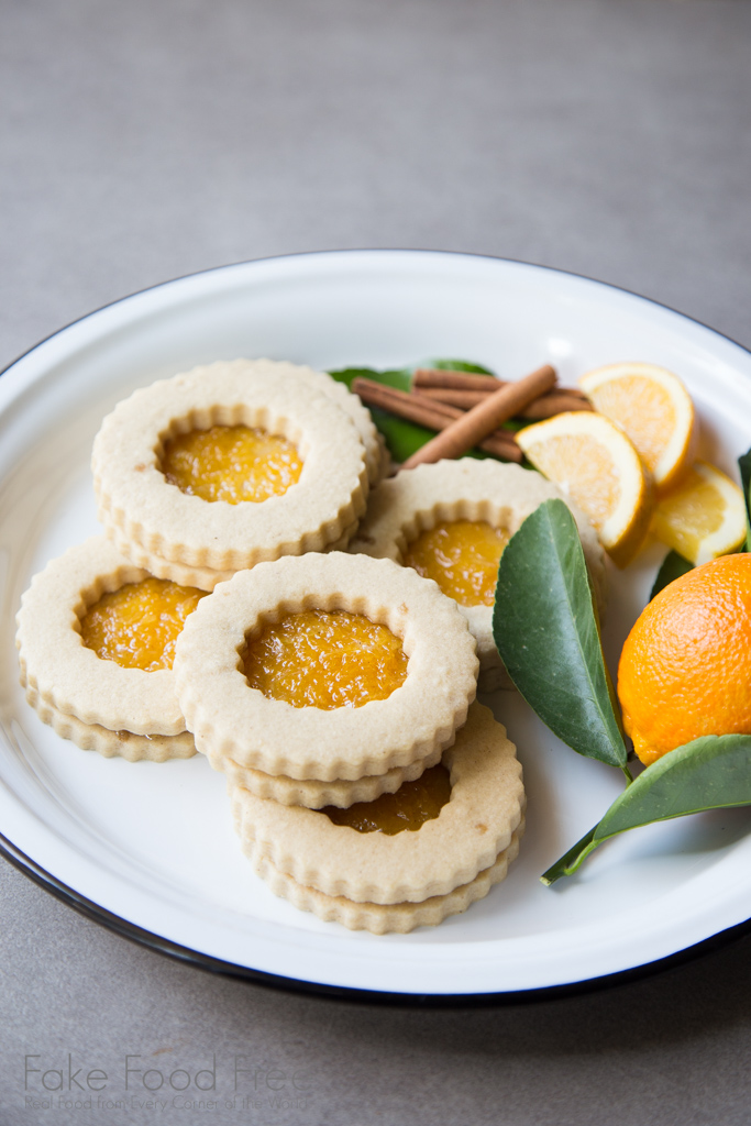 A recipe for festive cookies with ginger and rum, filled with orange jam. | FakeFoodFree.com