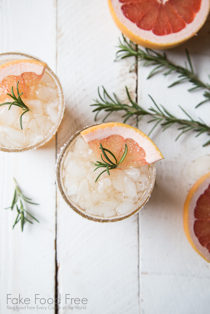 A twist on the Salty Dog Cocktail. This drink uses rosemary infused raw sugar simple syrup and combines with red grapefruit juice and vodka. | Find it at FakeFoodFree.com